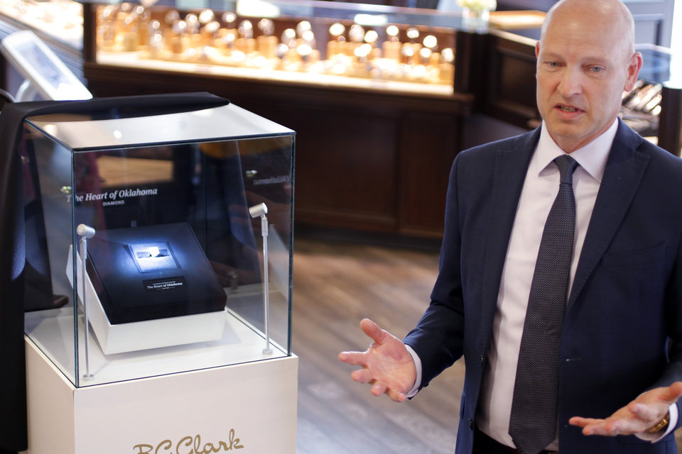 Photo - Coleman Clark tells the story of the Heart of Oklahoma diamond. Unveiling of the Heart of Oklahoma diamond at B.C. Clark Jewelers downtown store Friday, September 13, 2019. [Doug Hoke/The Oklahoman]