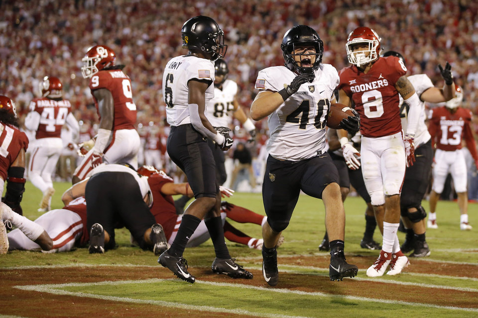 Photo - Army's Andy Davidson (40) celebrates after scoring a touchdown during a college football game between the University of Oklahoma Sooners (OU) and the Army Black Knights at Gaylord Family-Oklahoma Memorial Stadium in Norman, Okla., Saturday, Sept. 22, 2018. Photo by Bryan Terry, The Oklahoman