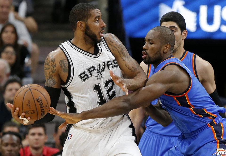 Photo - Oklahoma City's Serge Ibaka (9) defends San Antonio's LaMarcus Aldridge (12) during Game 5 of the second-round series between the Oklahoma City Thunder and the San Antonio Spurs in the NBA playoffs at the AT&T Center in San Antonio, Tuesday, May 10, 2016. Oklahoma City won 95-91. Photo by Bryan Terry, The Oklahoman