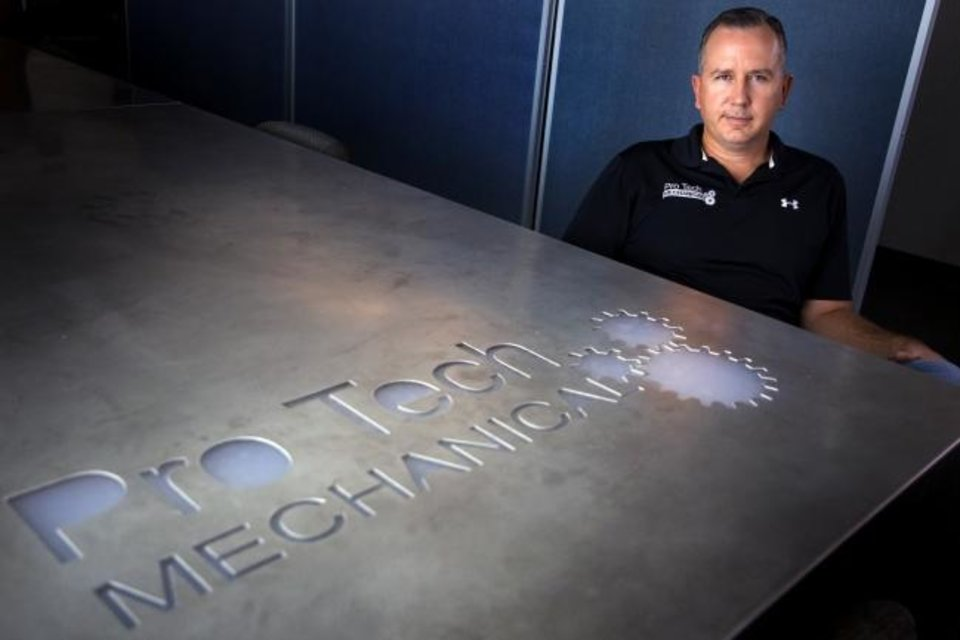 Photo -  Cory Lovelace, president of Pro Tech Mechanical, poses for a photo in his conference room. [CHRIS LANDSBERGER/THE OKLAHOMAN]