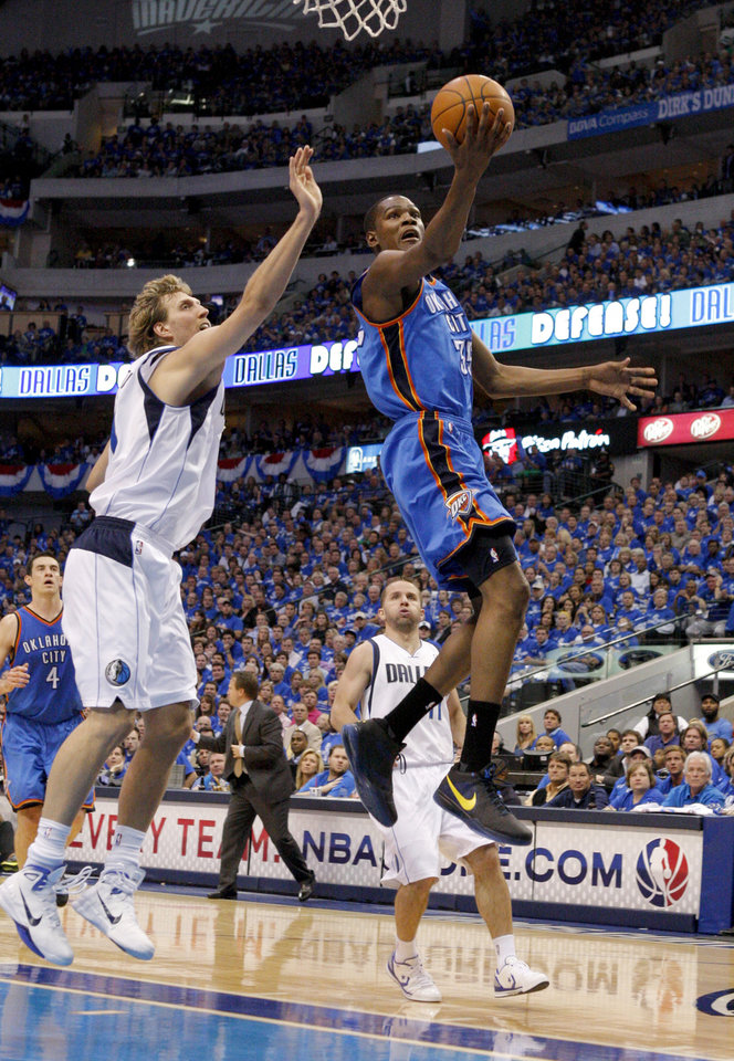 Photo - Oklahoma City's Kevin Durant (35) goes past Dirk Nowitzki (41) of Dallas during game 1 of the Western Conference Finals in the NBA basketball playoffs between the Dallas Mavericks and the Oklahoma City Thunder at American Airlines Center in Dallas, Tuesday, May 17, 2011. Photo by Bryan Terry, The Oklahoman