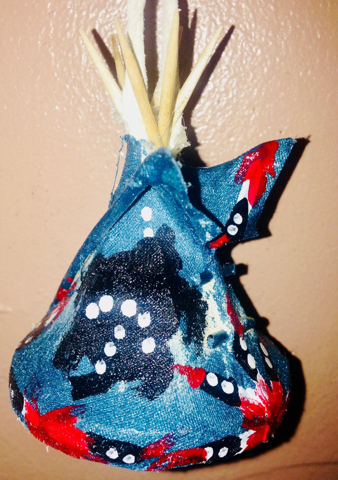 Photo -  A small decorative tepee by Comanche artist Tim Turtle is shown at White Buffalo Trading Post in Medicine Park. [PHOTO PROVIDED]