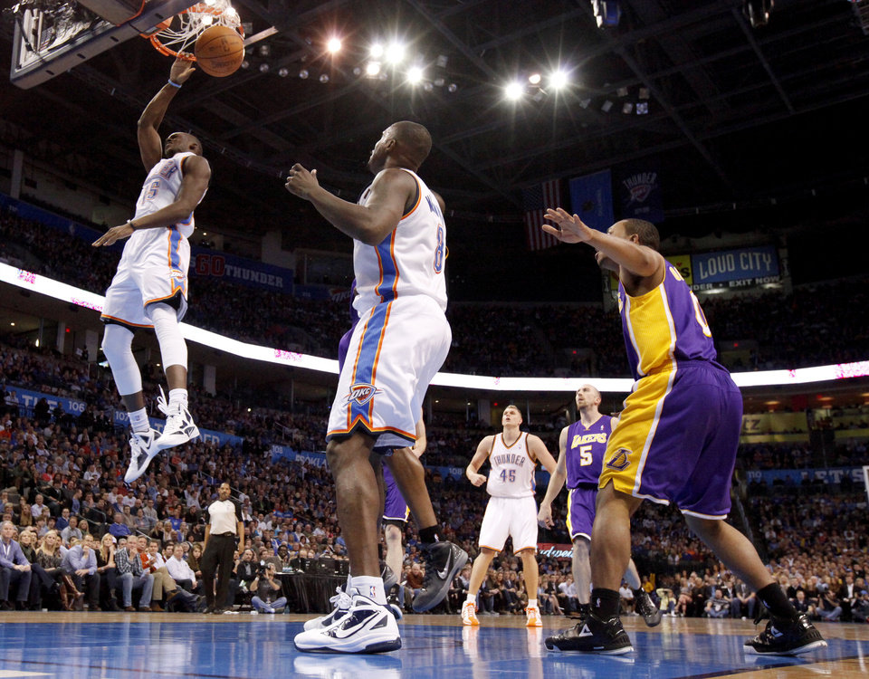 Photo - Oklahoma City's Reggie Jackson (15) dunks the ball during an NBA basketball game between the Oklahoma City Thunder and the Los Angeles Lakers at Chesapeake Energy Arena in Oklahoma City, Thursday, Feb. 23, 2012. Photo by Bryan Terry, The Oklahoman