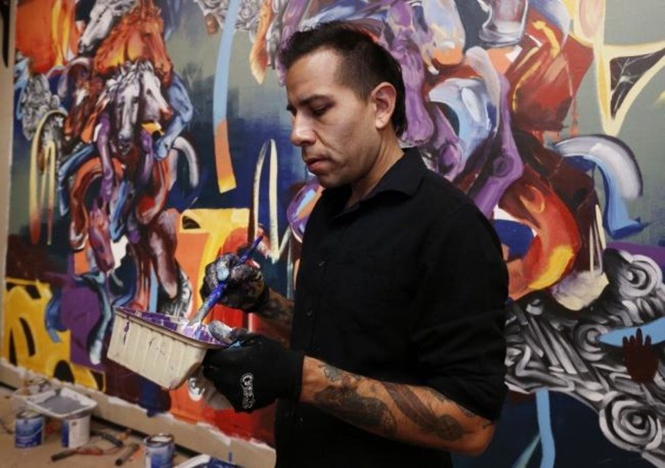 Photo -  Tulsa native Yatika Fields paints a mural in 2018 in Norman. He will paint a new landscape commissioned by Oklahoma Contemporary for