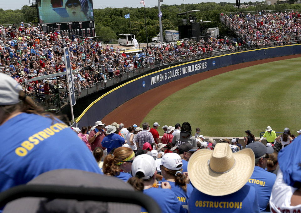 Photo - Fans in section 3 watch a game during Women's College World Series at USA Softball Hall of Fame Stadium in Oklahoma City,  Sunday, June 2, 2019. [Sarah Phipps/The Oklahoman]