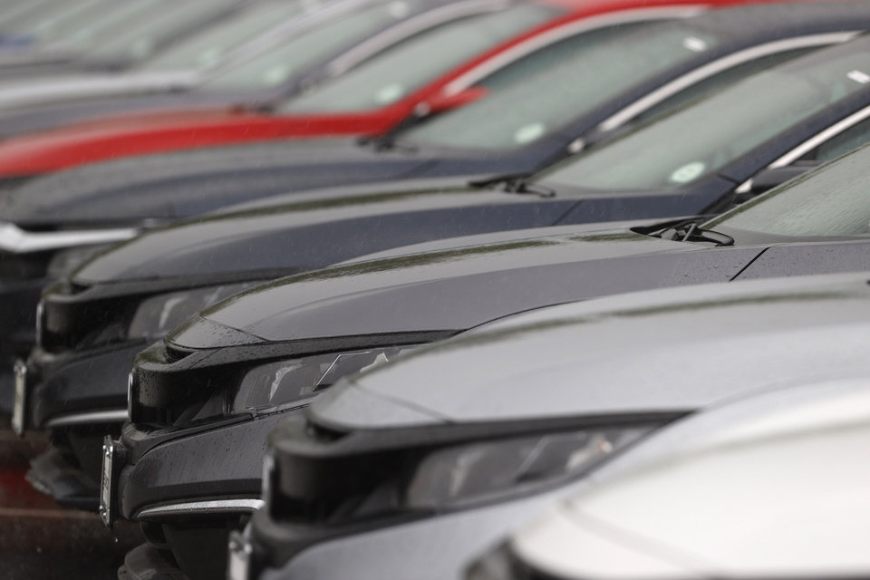 Photo - In this Sunday, May 24, 2020, photograph, a long line of unsold 2020 Accord sedans sits at a Honda dealership in Highlands Ranch, Colo. [AP Photo/David Zalubowski]