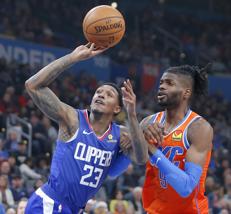 Photo - Oklahoma City's Nerlens Noel (9) defends LA's Lou Williams (23) during an NBA basketball game between the Oklahoma City Thunder and the LA Clippers at Chesapeake Energy Arena in Oklahoma City, Sunday, Dec. 22, 2019. Oklahoma City won 118-112.  [Bryan Terry/The Oklahoman]