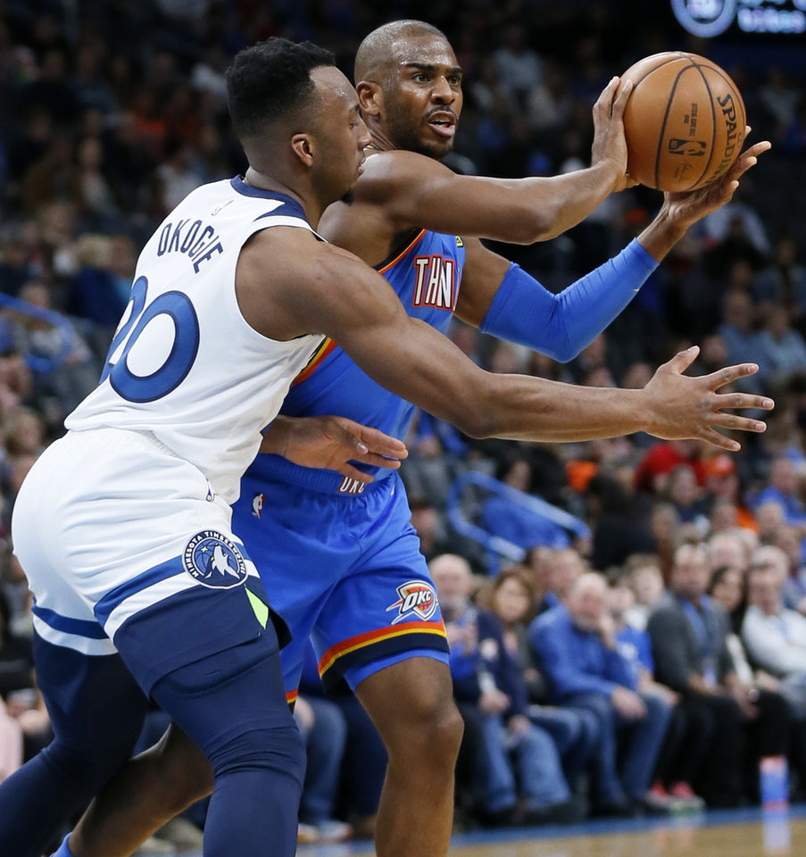 Photo - Oklahoma City's Chris Paul (3) passes away from Minnesota's Josh Okogie (20) during an NBA basketball game between the Minnesota Timberwolves and the Oklahoma City Thunder at Chesapeake Energy Arena in Oklahoma City, Friday, Dec. 6, 2019. [Nate Billings/The Oklahoman]