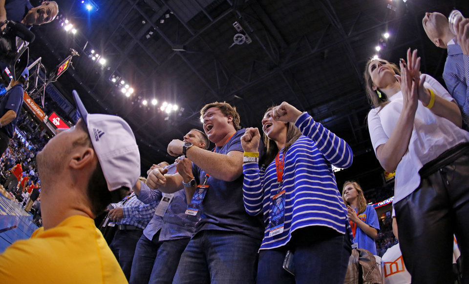 Photo - Fans cheer during an NBA basketball game between the Oklahoma City Thunder and the Houston Rockets at Chesapeake Energy Arena in Oklahoma City, Friday, Jan. 29, 2016. Oklahoma City won 116-108. Photo by Bryan Terry, The Oklahoman