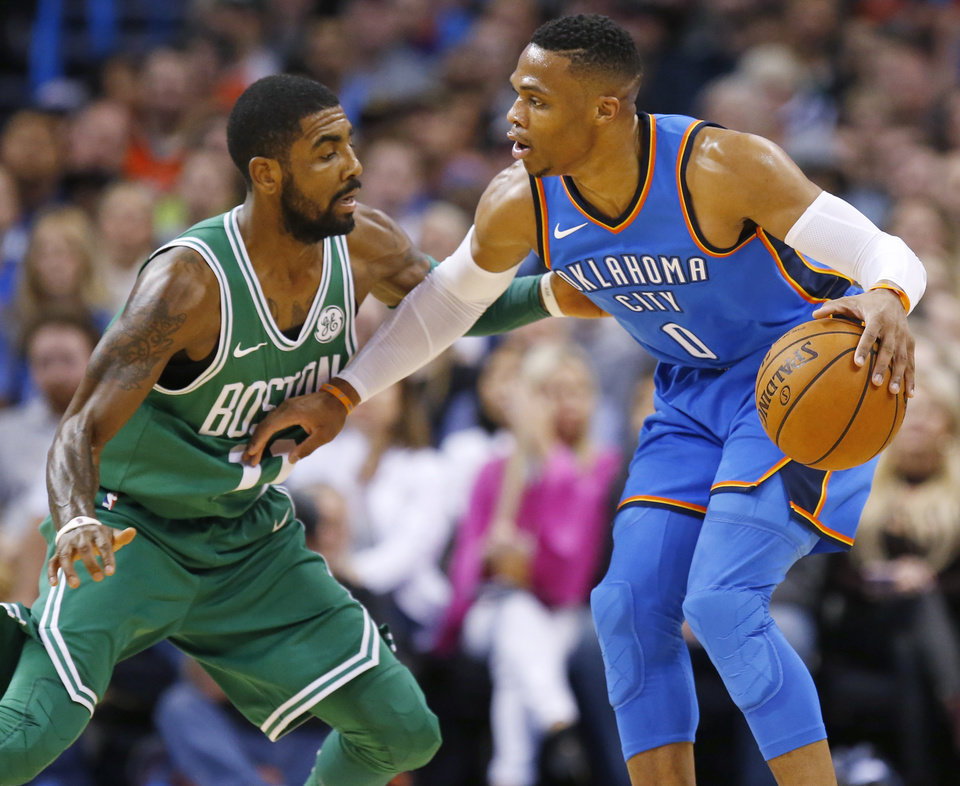 8c153e36f0b Oklahoma City s Russell Westbrook (0) works against Boston s Kyrie Irving  (11) during