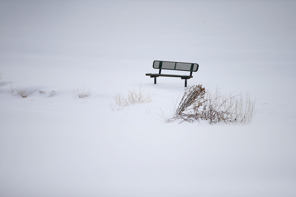 Photo - A park bench in the snow in northwest Oklahoma City after a winter storm dropped another layer of snow in Oklahoma City, Wednesday, Feb. 17, 2021. [Bryan Terry/The Oklahoman]