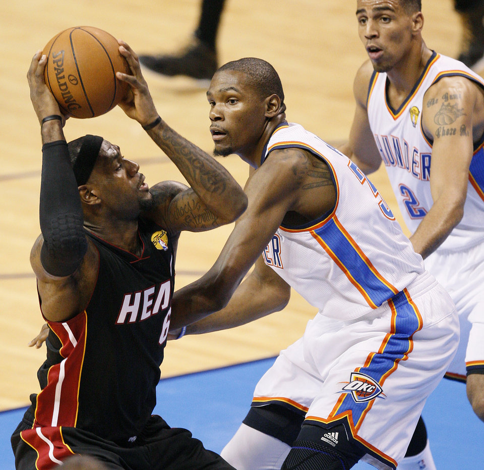 8041ceb582e5 Miami s LeBron James (6) tires to get by Oklahoma City s Kevin Durant (35)  and Oklahoma City s Thabo Sefolosha (2) during Game 2 of the NBA Finals  between ...