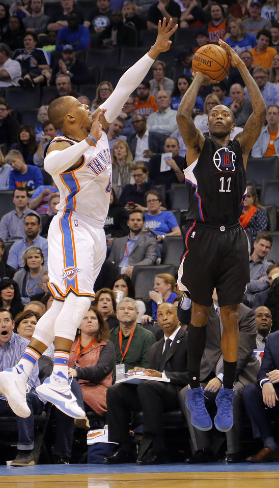 Photo - Los Angeles Clippers' Jamal Crawford (11) shoots the ball over Oklahoma City's Randy Foye (6) during the NBA basketball game between the Oklahoma City Thunder and the Los Angeles Clippers at Chesapeake Energy Arena on Wednesday, March 9, 2016, in Oklahoma City, Okla. Photo by Chris Landsberger, The Oklahoman