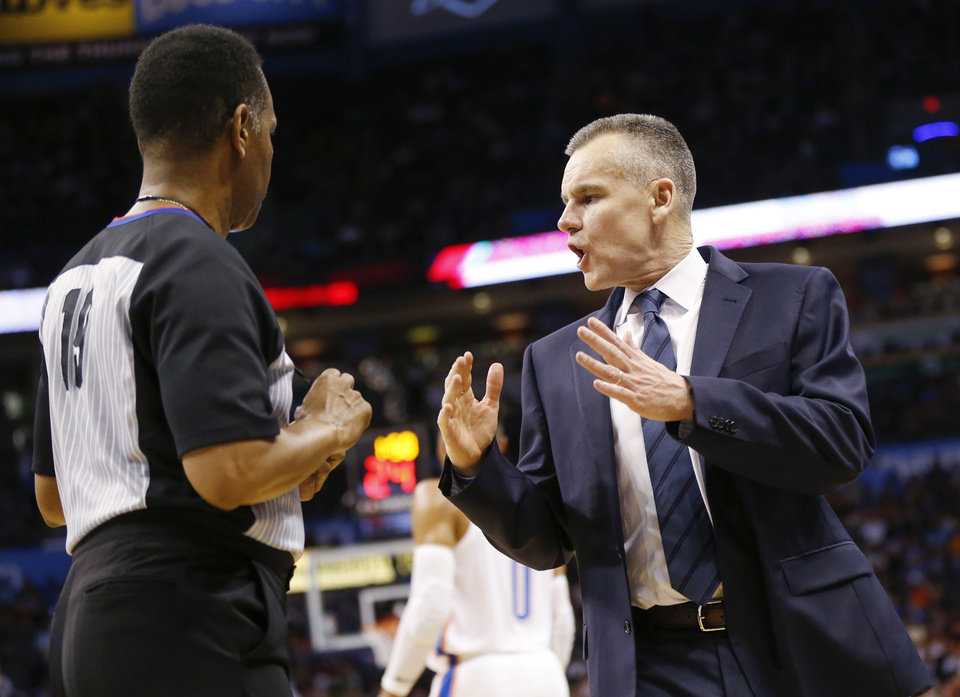 Photo - Oklahoma City head coach Billy Donovan, right, talks to official James Capers in the fourth quarter during an NBA basketball game between the Detroit Pistons and the Oklahoma City Thunder at Chesapeake Energy Arena in Oklahoma City, Friday, April 5, 2019. Oklahoma City won 123-110. Photo by Nate Billings, The Oklahoman