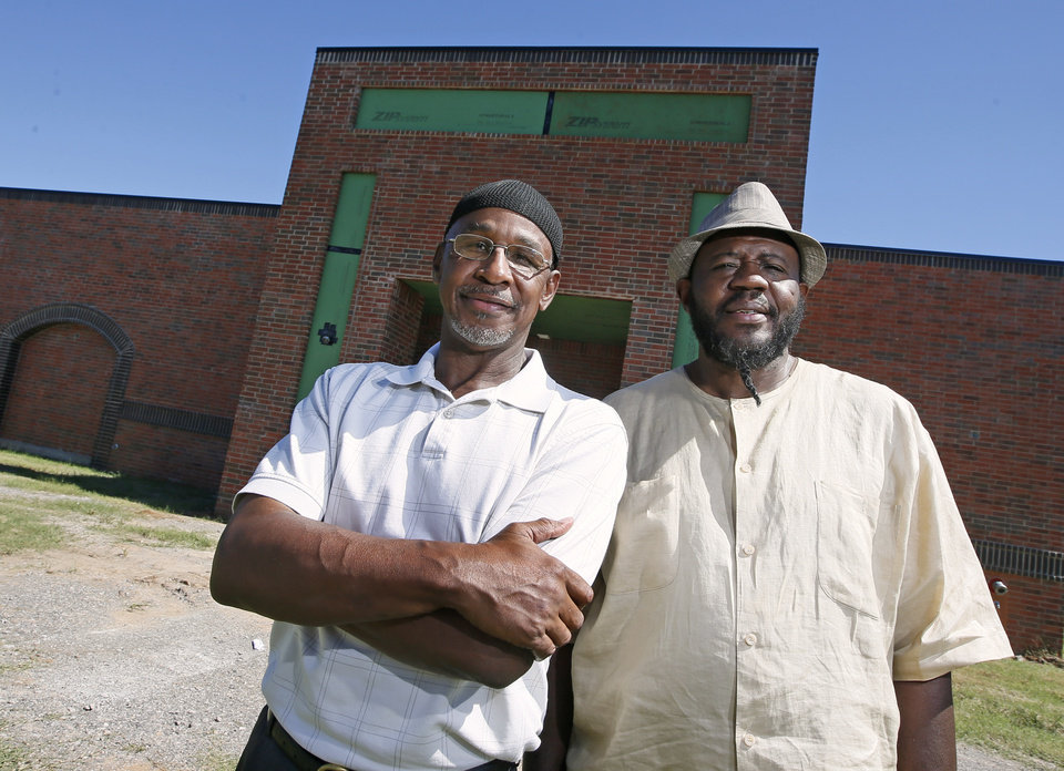 Photo -  Michael Aziz Gipson and Imam Arif Abdullah stand in front of the new Masjid Mu'min being constructed behind the current mosque at 1322 NW 23. [Photo by Nate Billings, The Oklahoman]