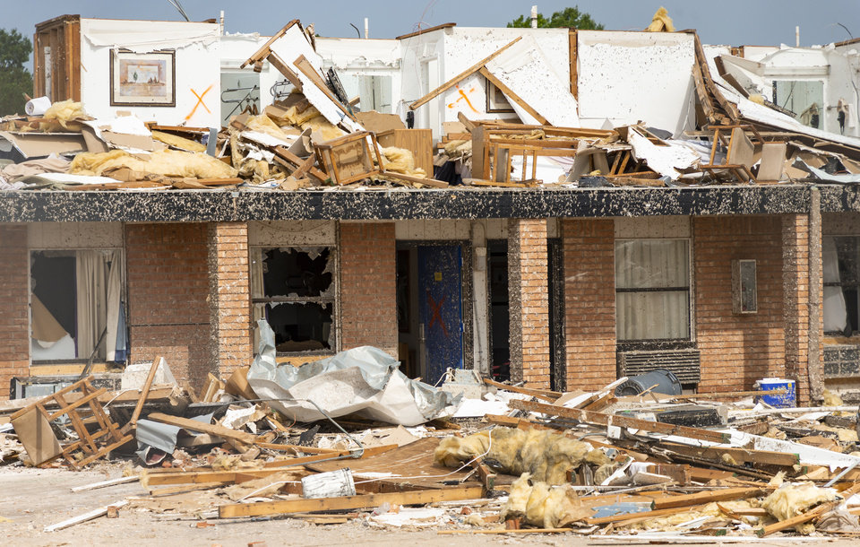 Photo - Storm damage and debris left behind at the American Budget Value Inn in the aftermath of a tornado in El Reno, Okla. on Monday, May 27, 2019. The EF3 tornado hit the area on Saturday night killing two people and injuring many others. [Chris Landsberger/The Oklahoman]