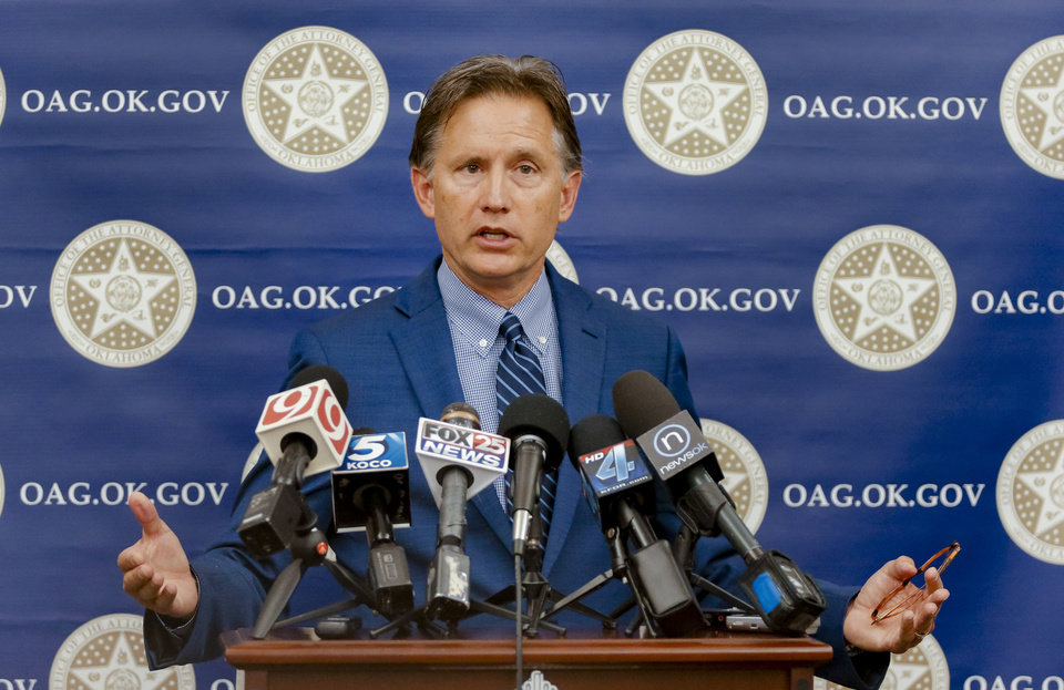 Photo - Attorney General Mike Hunter speaks during a press conference to announce the filing of a lawsuit against five opioid manufacturers for driving the opioid epidemic at the Oklahoma Attorney General's office in Oklahoma City, Okla. on Friday, June 30, 2017.  Photo by Chris Landsberger, The Oklahoman