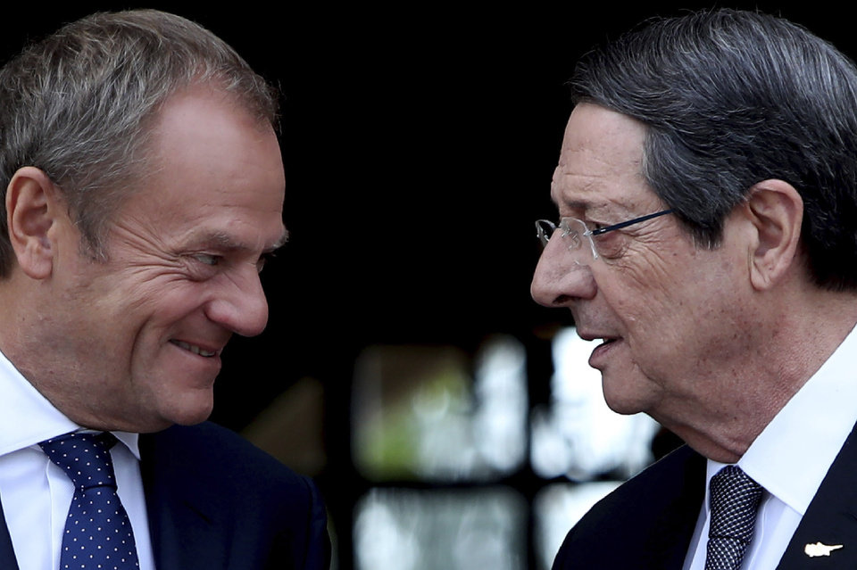 Photo -  Cyprus' President Nicos Anastasiades, right, talks with European Council President Donald Tusk as he arrives for a meeting at the presidential palace in divided capital Nicosia, Cyprus, Friday, Oct. 11, 2019. Tusk is in Cyprus for one-day visit. (AP Photo/Petros Karadjias)