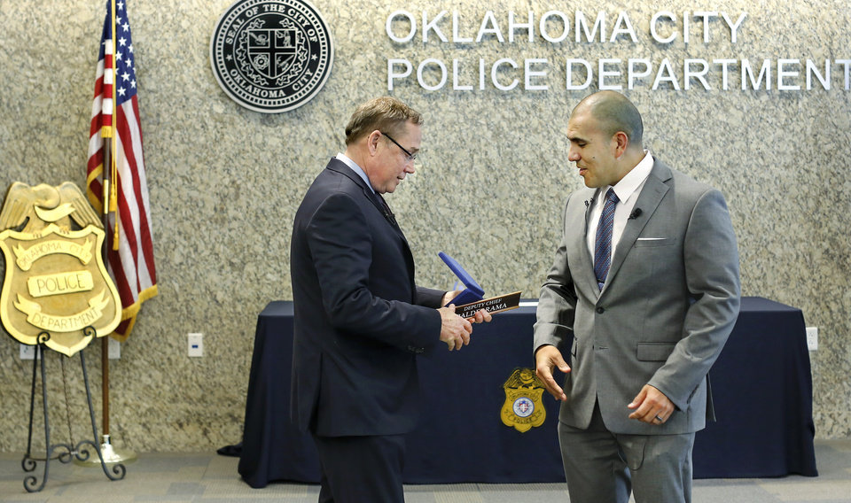 "Photo - During a ceremony at Oklahoma City Police headquarters Thursday morning, April 11, 2019, Major Paco Balderrama, right, made history when Chief Bill Citty, left,  formally promoted him to the rank of deputy chief, making him the first Hispanic to earn that rank in the department's history. Balderrama is a 20-year veteran of the department and has held various assignments during his time with OCPD. In 2000, Balderrama received the ""Rookie of the Year"" award after his first full year as a police officer. He has lived in Oklahoma City since 1993 and graduated from U.S. Grant High School in 1995. Photo by Jim Beckel, The Oklahoman."