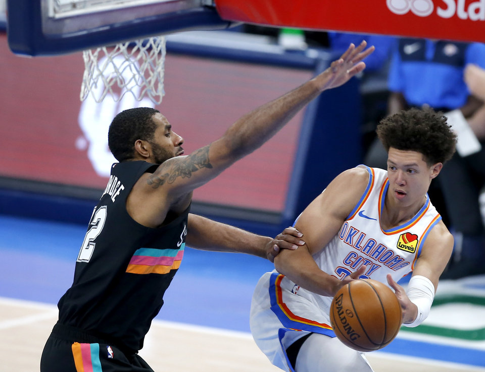 Photo - Oklahoma City's Isaiah Roby (22) passes the ball around San Antonio's LaMarcus Aldridge (12) in the third quarter of the NBA basketball game between the Oklahoma City Thunder and the San San Antonio Spurs at the Chesapeake Energy Arena, Wednesday, Feb. 24, 2021. [Sarah Phipps/The Oklahoman]