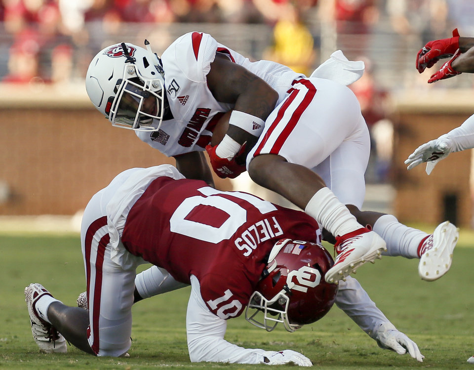Photo - Oklahoma's Pat Fields (10) trips up South Dakota's Canaan Brooks (25) in the first quarter during a college football game between the Oklahoma Sooners (OU) and South Dakota Coyotes at Gaylord Family - Oklahoma Memorial Stadium in Norman, Okla., Saturday, Sept. 7, 2019. [Nate Billings/The Oklahoman]