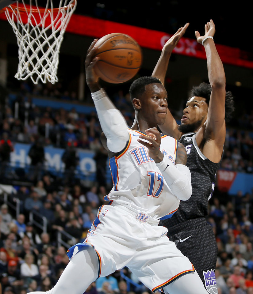 Photo - Oklahoma City's Dennis Schroder (17) passes as Sacramento's Marvin Bagley III (35)  defends during an NBA basketball game between the Oklahoma City Thunder and the Sacramento Kings at Chesapeake Energy Arena in Oklahoma City, Saturday, Feb. 23, 2019. Sacramento won 119-116. Photo by Bryan Terry, The Oklahoman