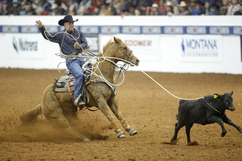 Photo - KC Jones of Burlington, Wyoming, competes in the tie-down roping event during the Timed Event Championship inside the Lazy E Arena in Guthrie, Okla., Friday, March 13, 2020. [Bryan Terry/The Oklahoman]