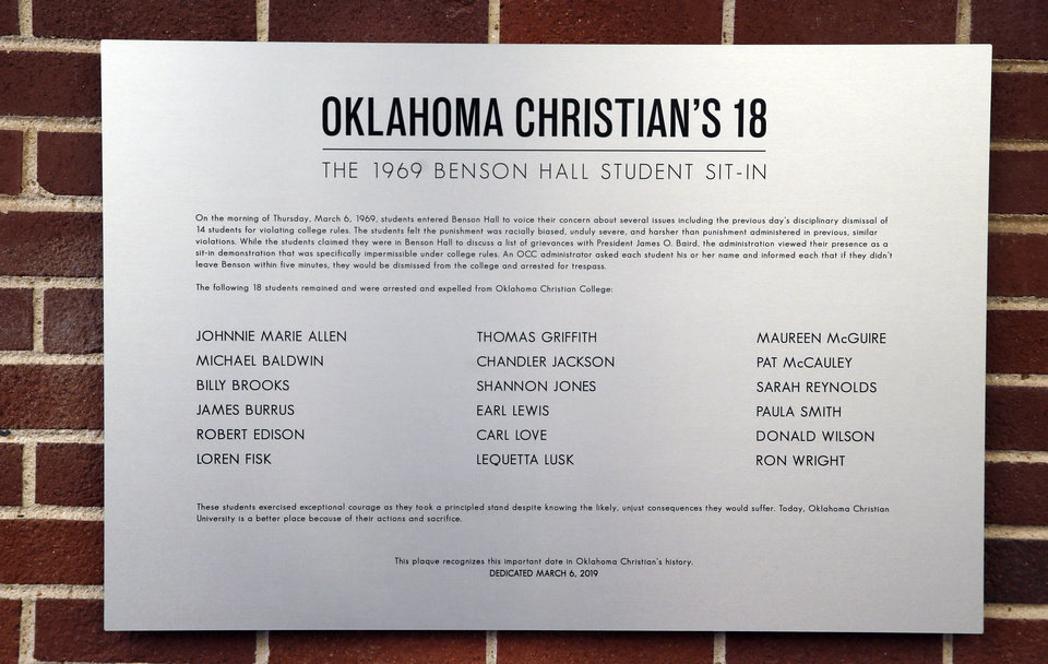 Photo - A plaque in Oklahoma Christian University's Benson Hall recognizing students who were expelled from then Oklahoma Christian College and arrested in 1969 after the Benson Hall sit-in to protest the expulsion of black basketball players who were accused of attending an interracial gathering off campus, in Oklahoma City, Wednesday, March 6, 2019. OC now refers to these students as Oklahoma Christian's 18. Photo by Nate Billings, The Oklahoman