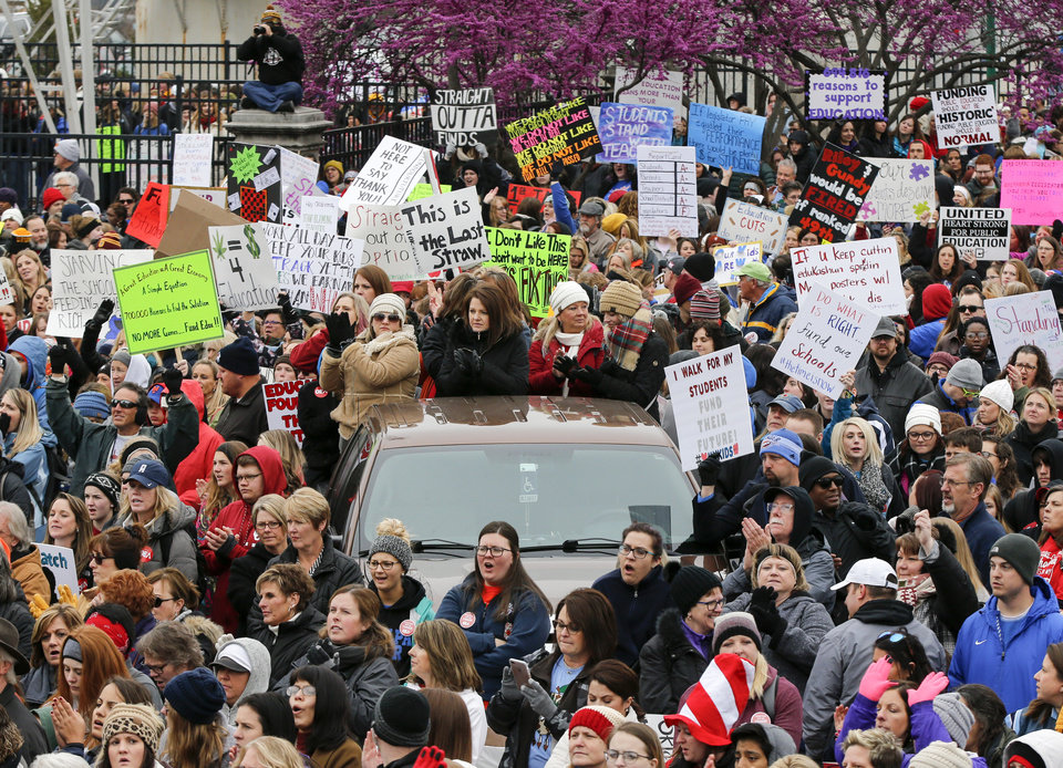 Photo - People listen to speakers during a rally and walkout by Oklahoma teachers at the state Capitol in Oklahoma City, Monday, April 2, 2018. Photo by Nate Billings, The Oklahoman