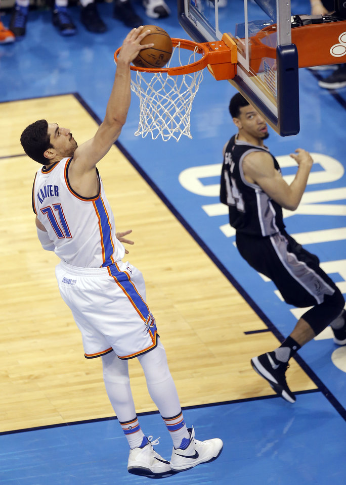 Photo - Oklahoma City's Enes Kanter (11) dunks the ball as San Antonio's Danny Green (14) looks on during Game 4 of the Western Conference semifinals between the Oklahoma City Thunder and the San Antonio Spurs in the NBA playoffs at Chesapeake Energy Arena in Oklahoma City, Sunday, May 8, 2016. Photo by Sarah Phipps, The Oklahoman