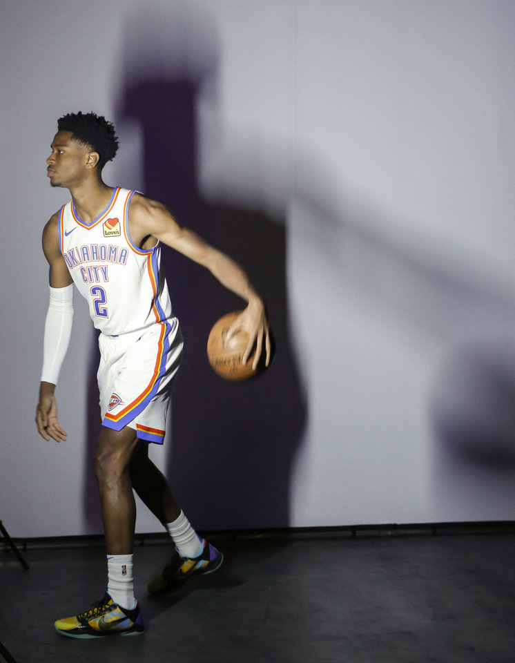 Photo - Oklahoma City's Shai Gilgeous-Alexander poses during a photo shoot at media day for the Oklahoma City Thunder NBA basketball team at Chesapeake Energy Arena in Oklahoma City, Monday, Sept. 30, 2019. [Nate Billings/The Oklahoman]