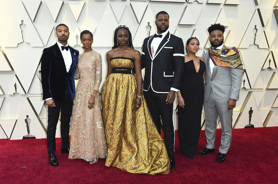 Photo -  Michael B. Jordan, from left, Letitia Wright, Danai Guriraz, Winston Duke, Zinzi Evans, and Ryan Coogler arrive at the Oscars on Sunday, Feb. 24, 2019, at the Dolby Theatre in Los Angeles. (Photo by Jordan Strauss/Invision/AP)