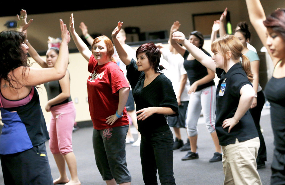 Photo - Students participate in a Zumba class Thursday at ASTEC Charter School. Photos by Bryan Terry, The Oklahoman