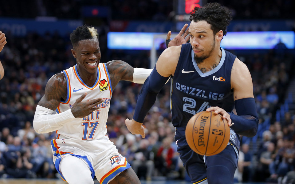 Photo - Memphis' Dillon Brooks (24) goes ast Oklahoma City's Dennis Schroder (17) during an NBA basketball game between the Oklahoma City Thunder and the Memphis Grizzlies at Chesapeake Energy Arena in Oklahoma City, Wednesday, Dec. 18, 2019. [Bryan Terry/The Oklahoman]