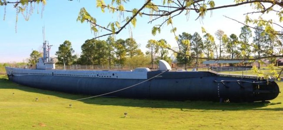 Photo -  The USS Batfish, which was launched in 1943 and holds the record as the most successful submarine-killing sub, is a museum on a grassy depression above a river bank in Muskogee. [Beth Stephenson]