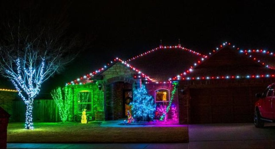 Photo -  The house at 124 SW 175 Terrace is decorated for the holidays. [CHRIS LANDSBERGER/THE OKLAHOMAN]