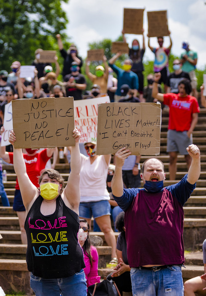 Photo - Protesters gather with signs that carry their message during a protest at Andrews Park on Monday, June 1, 2020, in Norman, Okla. in response to the death of George Floyd.  [Chris Landsberger/The Oklahoman]