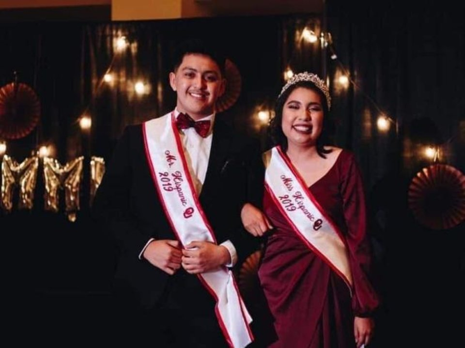 Photo -  Rosalinda Espinosa, right, poses with Oscar Carreon after they were crowned the 2019 Mr. and Miss Hispanic University of Oklahoma in April. [Stephanie Montelongo/Hispanic American Student Association]