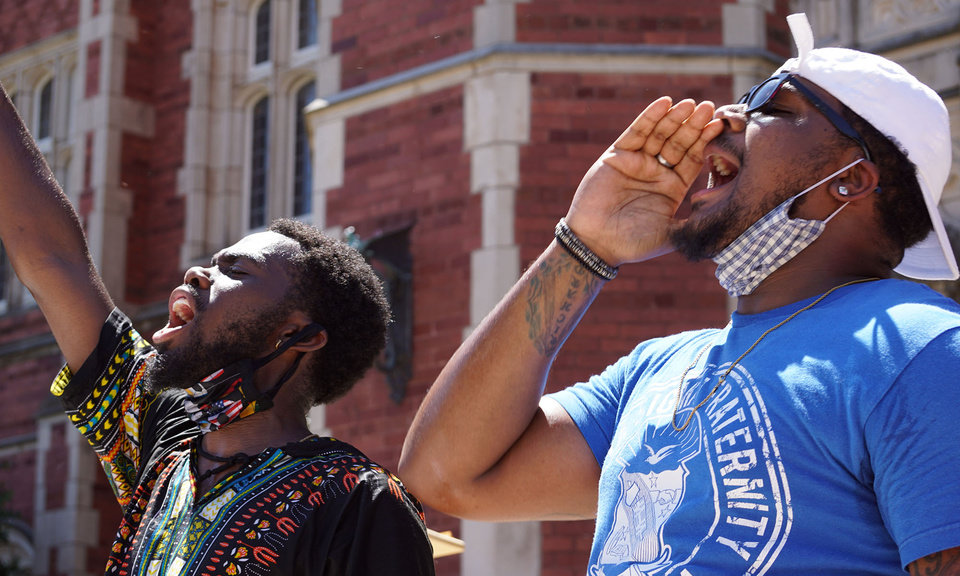 Photo - Michael Hold (left) and Picasso Knowles lead chants in front of the University of Oklahoma's Evans Hall during the George Floyd protest on Saturday, June 6, 2020, in Norman, Okla. [Ellie Melero/The Oklahoman]