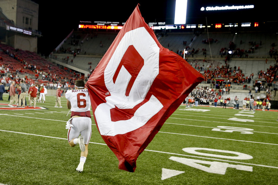 836f3c48969 Sooners quarterback Baker Mayfield ran to midfield to plant the OU at Ohio  Stadium after beating Ohio State on Sept. 9.  PHOTO BY IAN MAULE