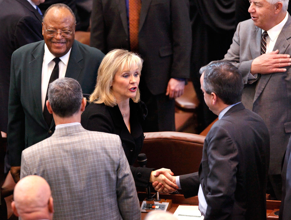 Photo - Gov. Mary Fallin chats with lawmakers as she leaves the House Chamber after delivering her 2012 State of the State address to a joint session of the Oklahoma legislature on the opening day of the session, Monday, Feb, 6, 2012.   Photo by Jim Beckel, The Oklahoman