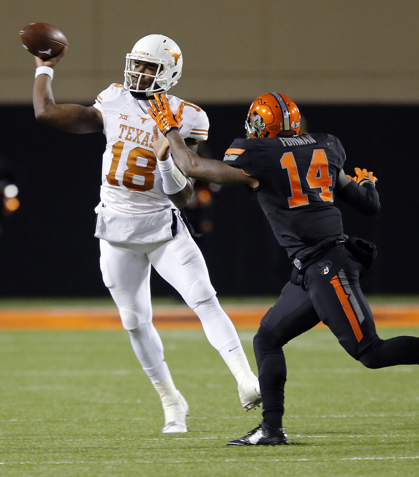 Photo - Texas' Tyrone Swoopes (18) throws the ball in front of Oklahoma State's Josh Furman (14) during the college football game between the Oklahoma State University Cowboys (OSU) the University of Texas Longhorns (UT) at Boone Pickens Staduim in Stillwater, Okla. on Saturday, Nov. 15, 2014.  Photo by Chris Landsberger, The Oklahoman