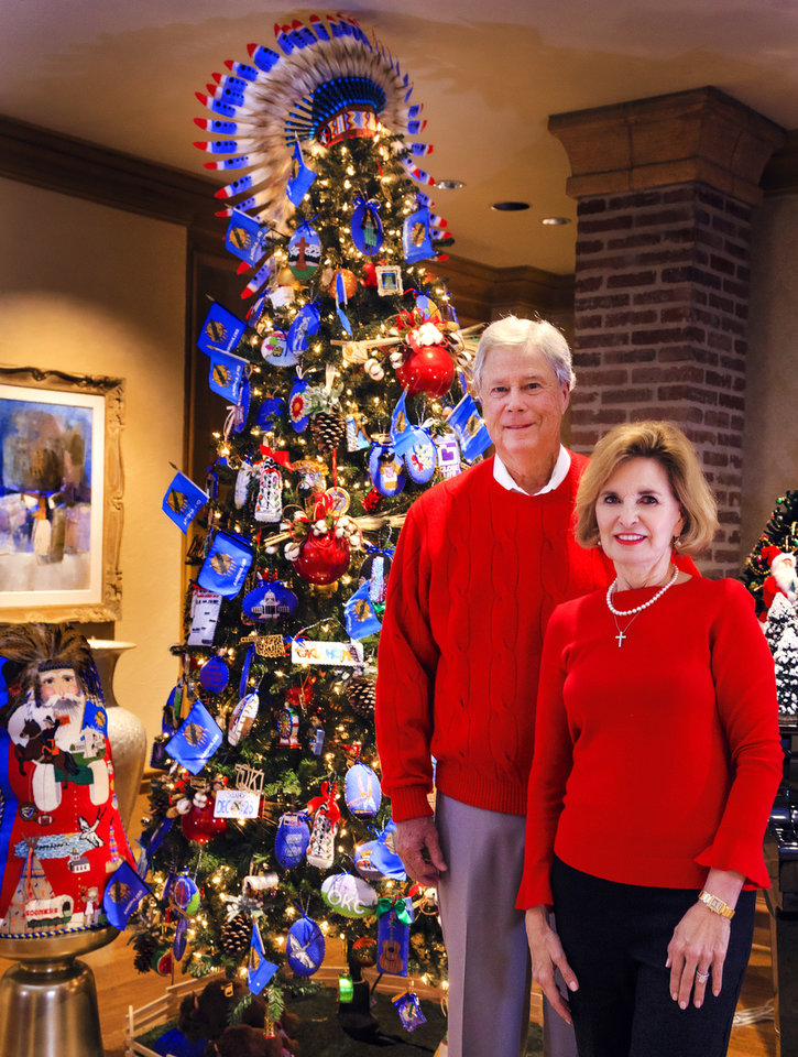 "Photo -  Bob and Candy Reece stand in front of their ""Oklahoma"" Christmas tree. [PHOTO BY CHRIS LANDSBERGER, THE OKLAHOMAN]"