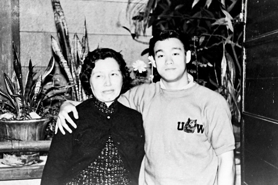 Photo -  A young Bruce Lee poses with his mother. [David Tadman]