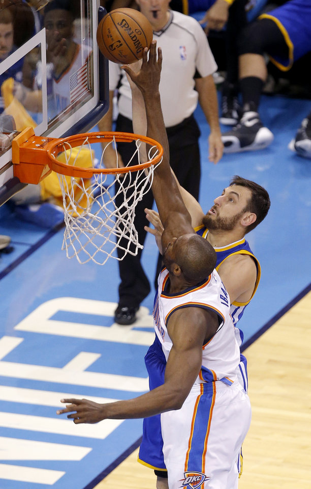 Photo - Oklahoma City's Serge Ibaka (9) blocks the shot of Golden State's Andrew Bogut (12) during Game 6 of the Western Conference finals in the NBA playoffs between the Oklahoma City Thunder and the Golden State Warriors at Chesapeake Energy Arena in Oklahoma City, Saturday, May 28, 2016. Photo by Bryan Terry, The Oklahoman