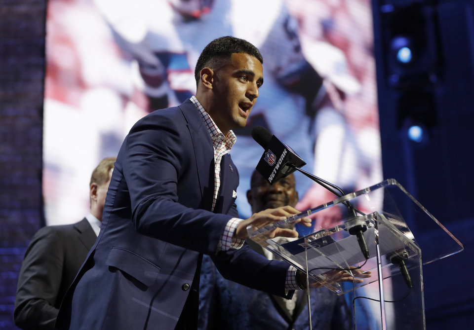 Photo - Tennessee Titans quarterback Marcus Mariota speaks ahead of the first round at the NFL football draft, Thursday, April 25, 2019, in Nashville, Tenn. (AP Photo/Mark Humphrey)