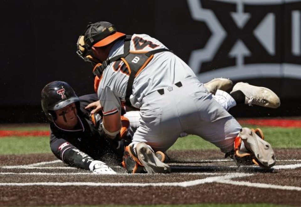 Photo -  Texas Tech's Brian Klein (5) slides safely into home plate around Oklahoma State's Colin Simpson (24) during the fourth inning in Game 1 of an NCAA college baseball super regional tournament Friday, June 7, 2019, in Lubbock, Texas. (AP Photo/Brad Tollefson)