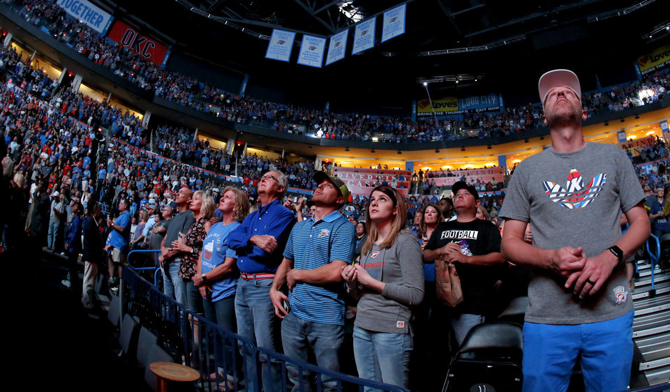 Photo - Thunder fans cheer before an NBA basketball game between the Oklahoma City Thunder and the Phoenix Suns at Chesapeake Energy Arena in Oklahoma City, Friday, Oct. 28, 2016. Photo by Bryan Terry, The Oklahoman