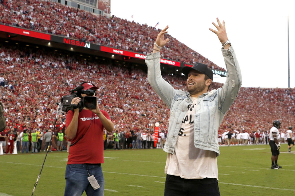 Photo - Former Oklahoma quarterback Baker Mayfield gestures toward the crowd during a college football game between the University of Oklahoma Sooners (OU) and the Army Black Knights at Gaylord Family-Oklahoma Memorial Stadium in Norman, Okla., Saturday, Sept. 22, 2018. Photo by Bryan Terry, The Oklahoman