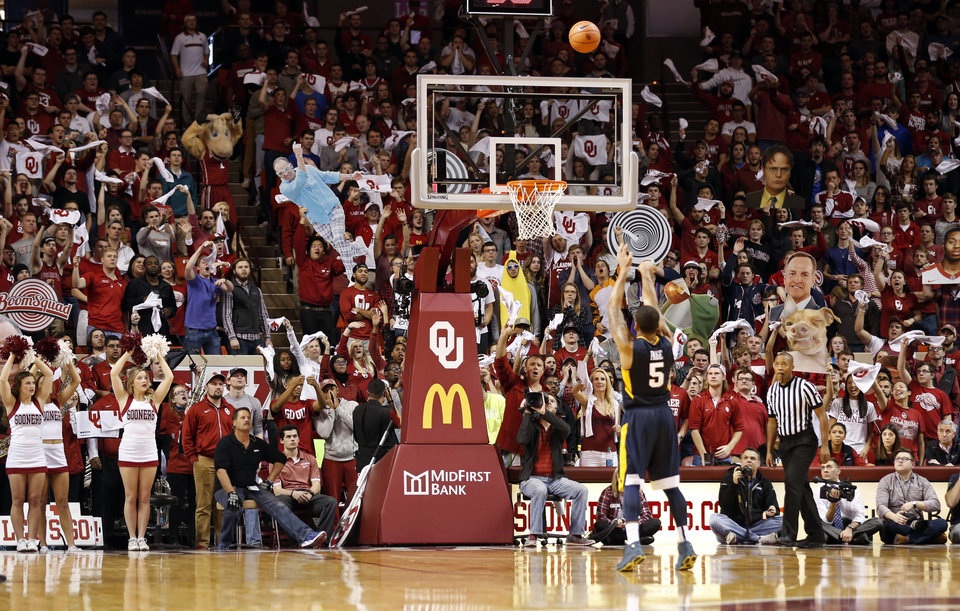 Photo - West Virginia's Jaysean Paige (5) shoots a free throw after a technical foul with fan distractions as the University of Oklahoma Sooner (OU) men defeat the West Virginia Mountaineers (WV) 70-68 in NCAA, college basketball at The Lloyd Noble Center on Jan. 16, 2016 in Norman, Okla. Photo by Steve Sisney, The Oklahoman
